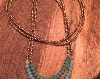 Ice blue multi-strand beaded necklace