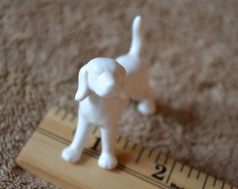 white porcelain standing dog figurine