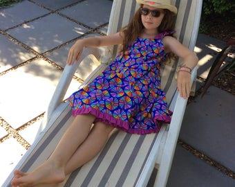 Tweens sun dress in multi coloured print with fuchsia frill