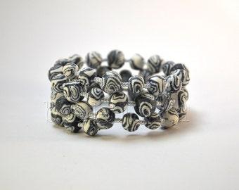 """Spiral bracelet """"Helia"""", grey"""