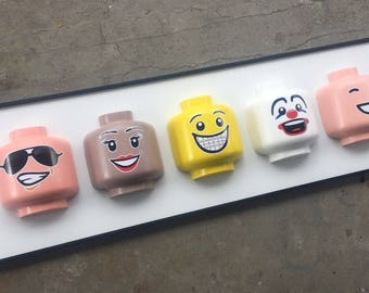 Toy Head Smiles / Framed