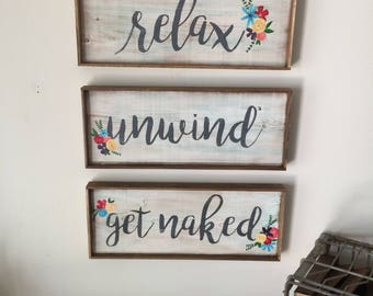 Relax, Unwind, get naked trio bathroom signs