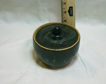 small covered dark blue vase