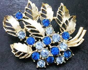 Vintage Gold Tone Brooch with Light and Dark Blue Rhinestones and Gold Tone Leaves Forming a Pretty Floral Bouquet