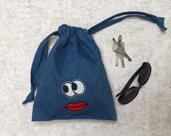 1 blue denim bag with eyes and mouth - single