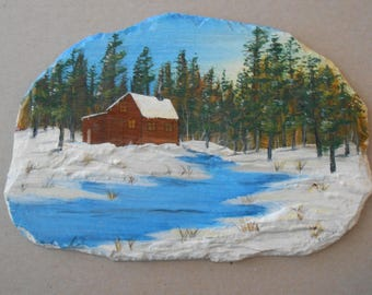 Snowy Landscape of Cabin by stream on Slate