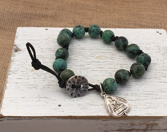 Single Wrap Round Leather Knotted Bracelet with 10mm African Turquoise beads and Buddha medallion.