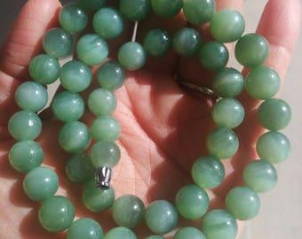 Siberian Chatoyant/ cat's eye nehprite bead strand