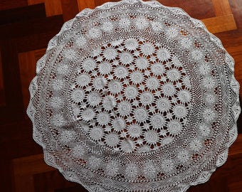 Small round vintage crocheted tablecloth. Proceeds to charity