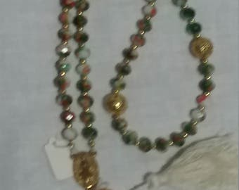 Green and orange and white five decade paternoster prayer beads