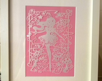 A Beautiful dancing fairy handcut papercut wall decor.