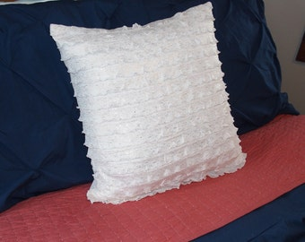 "White ruffled pillow 18""x18"" with gold fleck backed with a light pink corduroy and covered buttons."