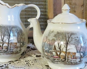 Avon Ceramic Pitcher and Teapot with Winter Cabin Illustration