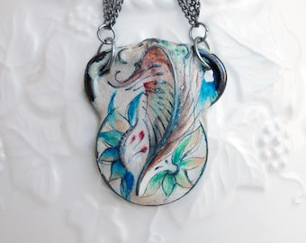 Three small painted pendants on multiple chains, necklace in blue, teal, green, brown, cream and touches of rose.