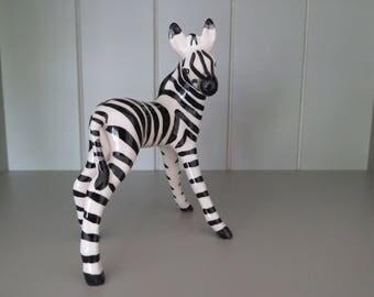 Cute little vintage zebra foal figurine.