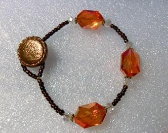 "Orange + bronze glass beads,button + loop bracelet 7.75"" 19.5cm"