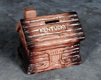 Ceramic Kentucky Log Cabin Coin Bank