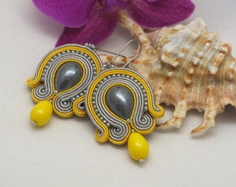 Earrings made in soutache embroidery technique