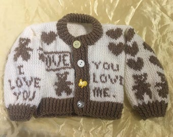 "Hand knitted baby boys cardigan in cream and brown acrylic with teddy and heart theme and ""I love you"" knitted into it"