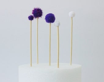 Purple and White Pom Pom Cake Toppers