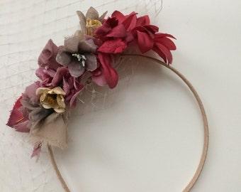 Handmade brides flower headpiece with birdcage veil.