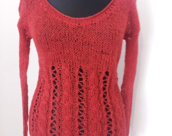Hand knitted red shirt with holes