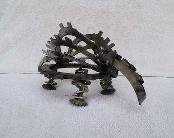 welded scrap metal armadillo sculpture