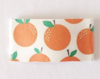 Orange party faux leather snap clip