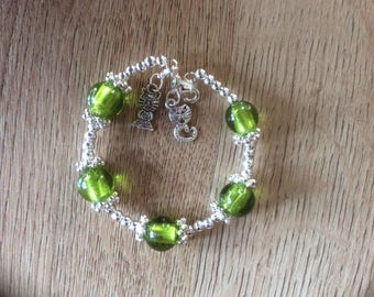 Green memory wire bracelet with cat charms