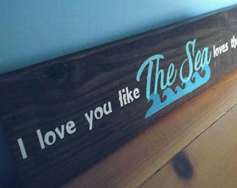 I love you like the sea loves the shore sign