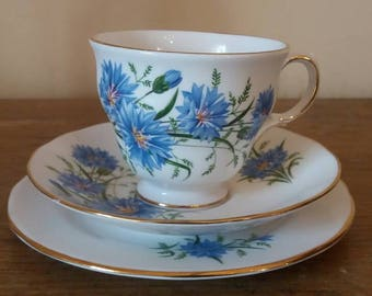 Queen Anne bone china trio (teacup saucer and side plate) with blue cornflower design, made in England.