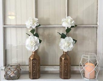 Gold whiskey bottle vases