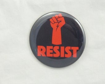 Resist Button. pin-back button. Resist pin. Resist. Red Power Fist. Resistance Buttons