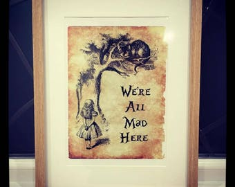 Framed Alice In Wonderland 'We're All Mad Here' print