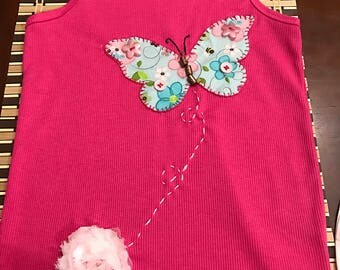 Girl's pink t-shirt with butterfly