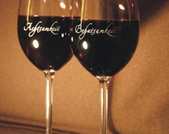 """2 wine glasses, lovingly engraved with """"Happiness"""" and """"Joie de vivre"""""""