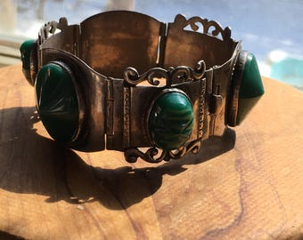 1940s Taxco sterling silver and green onyx bracelet with carved masks and large cabochons, Mexico