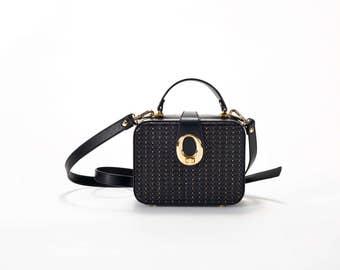 black leather braided hand bag