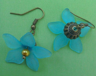 Blue lucite flower bronze plated earrings
