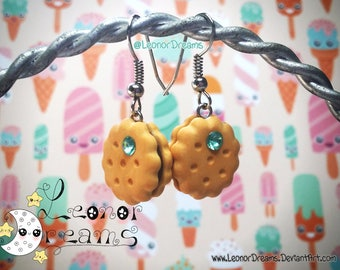 Earrings of biscuits with chocolate made with polymer clay and decorated with a bright blue. Handmade.