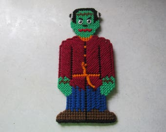 Halloween Frankenstein decoration made of plastic canvas and yarn with magnets attached to back