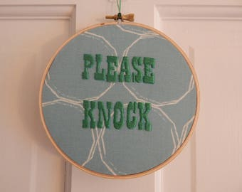 Please Knock Embroidered Wall Hanging