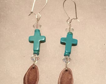 Turquoise cross on caribou antler