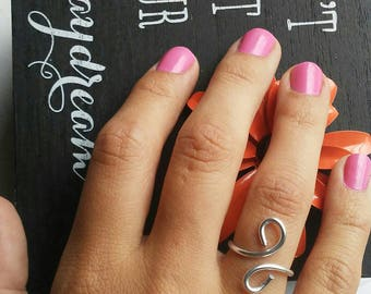 Simple double swirl adjustable ring