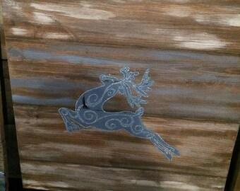 Blue flying reindeer wall hanging