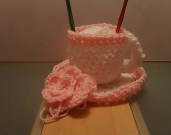 Crocheted tea cup and saucer