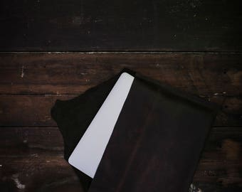 Handmade genuine leather laptop sleeve.