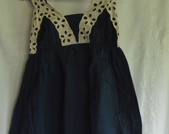Navy blue babydoll blouse with white trim