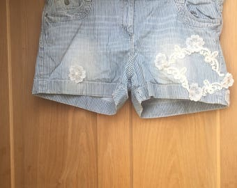 size 18, blue and white stripped shorts. white lace on the side of the leg.