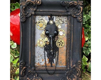 Steampunk and gothic bird skull wall hanging